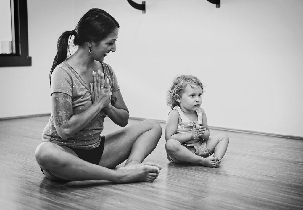mom and baby doing yoga