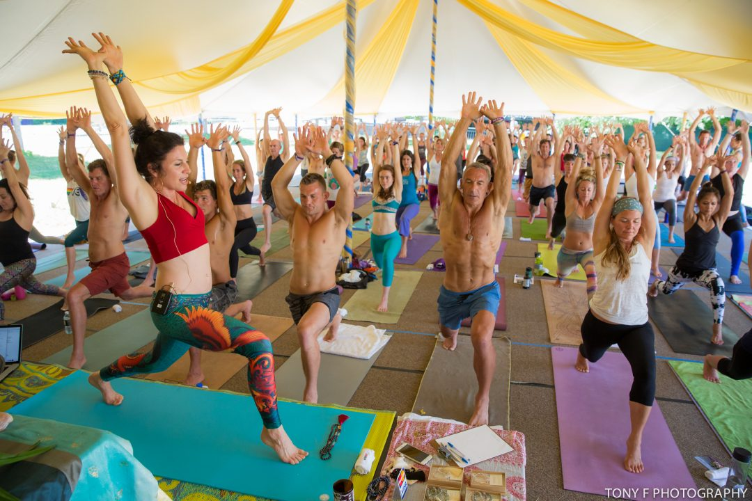 teaching yoga at festival