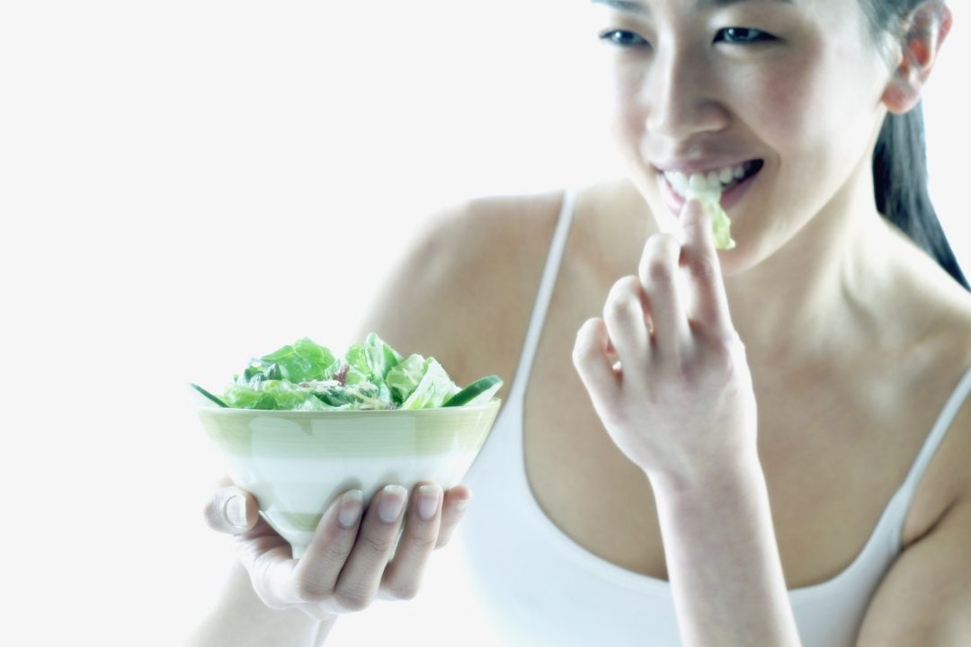 yoga woman eating salad