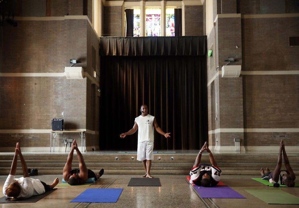 Marshawn Feltus leads an ACT Yoga class