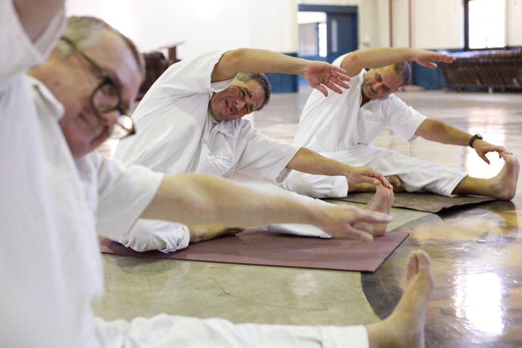inmates practicing yoga in prison