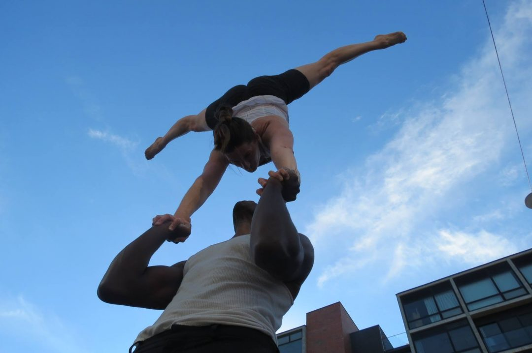 Lex Peters performing acro yoga