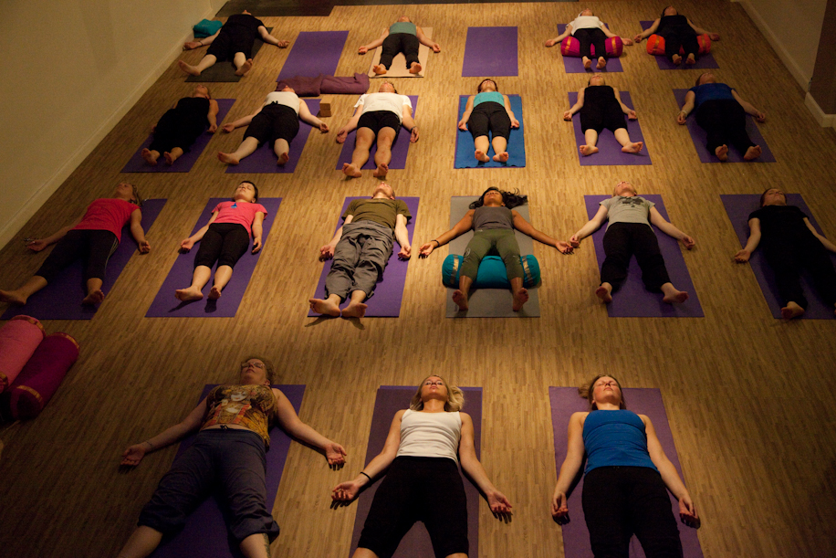 yoga students in shavasana
