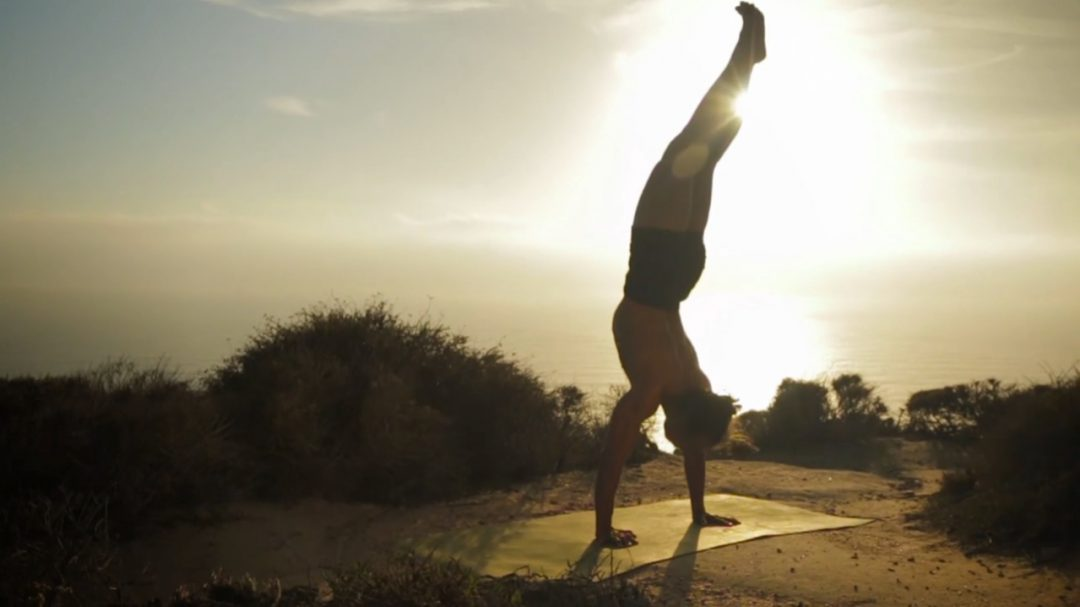 Yoga teacher handstand