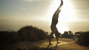 Yoga teacher handstand