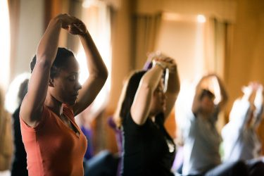 yoga class with diverse students