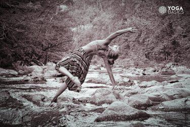 woman doing yoga Balancing Rajas Guna